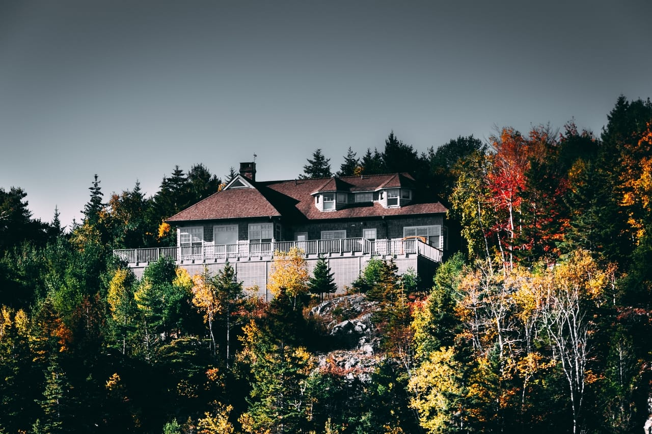 house-on-hill-with-fall-trees