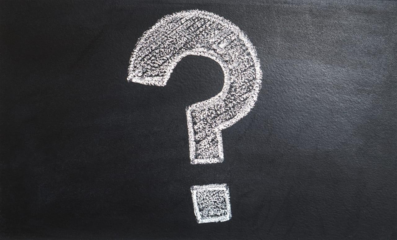 white-chalk-question-mark-on-blackboard